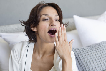 Woman yawning on the bed