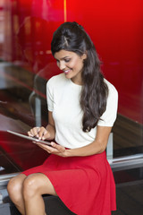 Woman using a digital tablet and smiling