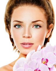 beautiful woman with pink orchid