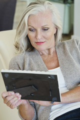 Woman looking at a picture frame