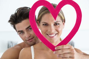 Couple with a heart shape object