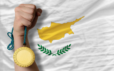 Gold medal for sport and  national flag of cyprus