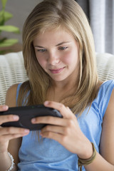 Close-up of a girl playing video game