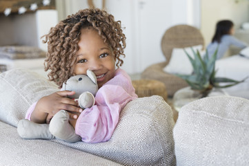 Portrait of a smiling girl holding a teddy bear