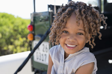 Portrait of a girl sitting in a SUV and smiling