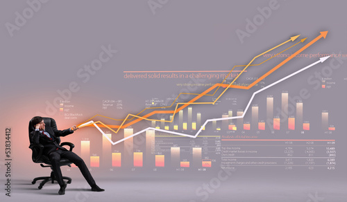 Businessman pulling graph
