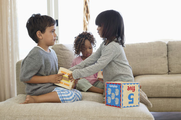 Children playing with number blocks
