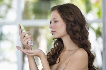 Woman holding a moisturizer bottle