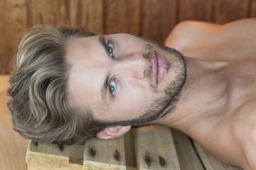 Portrait of a man resting in a sauna