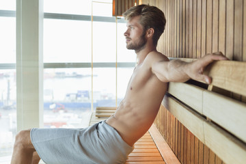 Man relaxing in a sauna