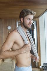 Man standing in a sauna