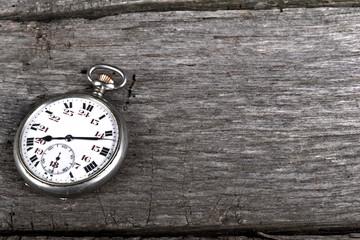 vintage pocked watch on old wood