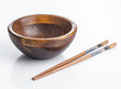 empty wooden bowl with chinese chopsticks decorated