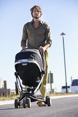 Man pushing a baby stroller