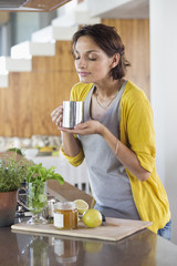 Woman smelling herbal tea