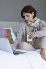 Woman working on a laptop and looking upset