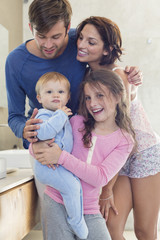 Happy family in a bathroom