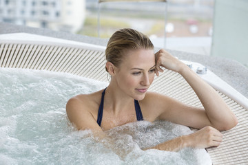 Beautiful woman in a hot tub