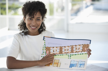 Real estate agent showing a plan