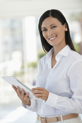 Portrait of a businesswoman using a digital tablet in an office