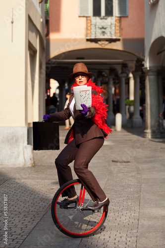 business woman go to work in monocycle