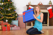 blonde woman with blue christmas present