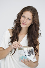 Portrait of a woman holding a make-up bag
