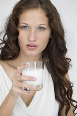 Portrait of a woman drinking milk