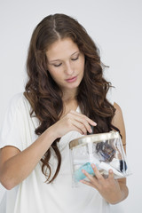 Woman holding a make-up bag