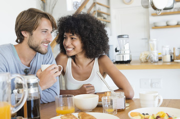 Couple sitting at a dining table having breakfast