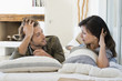 Couple lying on the bed and looking at each other