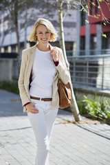 Portrait of a smiling woman walking on a street