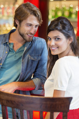 Smiling couple at a restaurant