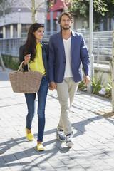 Happy couple walking on a street