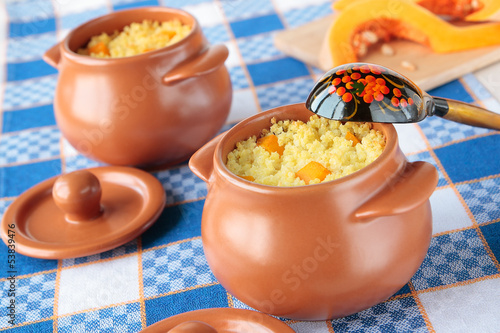 Two pots of millet porridge with pumpkin