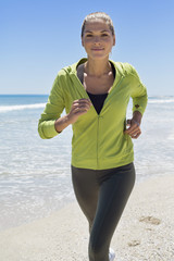 Portrait of a woman running on the beach