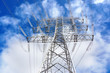 canvas print picture - High voltage transmission tower against blue sky