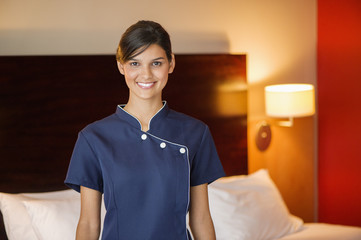 Portrait of a maid smiling in a hotel room