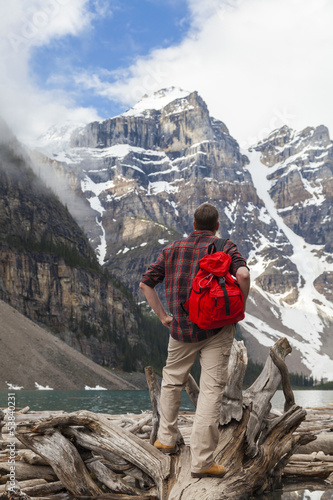Hiking Man Looking at Moraine Lake & Rocky Mountains