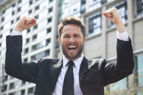 Young Successful Business Man Celebrating in City