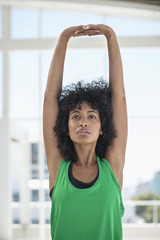 Woman stretching out her arms