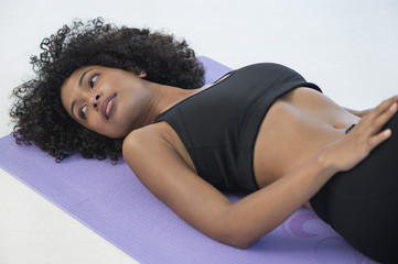 Woman lying on an exercise mat