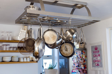 Cooking utensils hanging in the kitchen