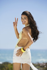 Beautiful woman gesturing on the beach