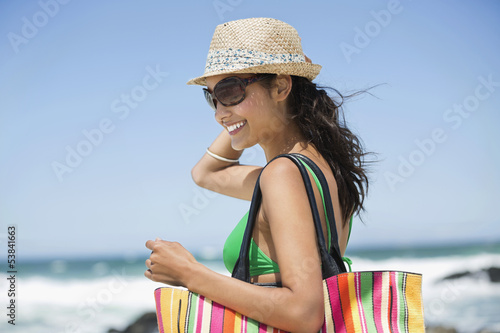 Beautiful woman smiling on the beach