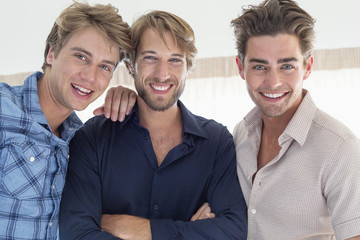 Portrait of three friends smiling together