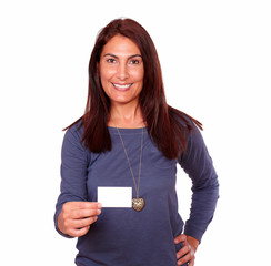 Smiling senior woman holding up a blank card