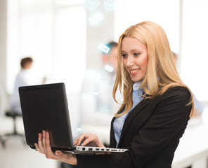 woman with laptop computer in office