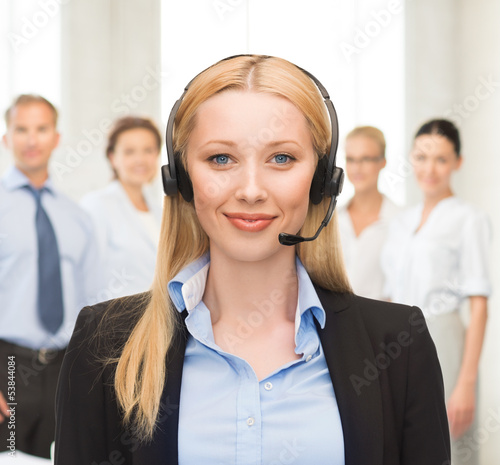 helpline operator with headphones in call centre
