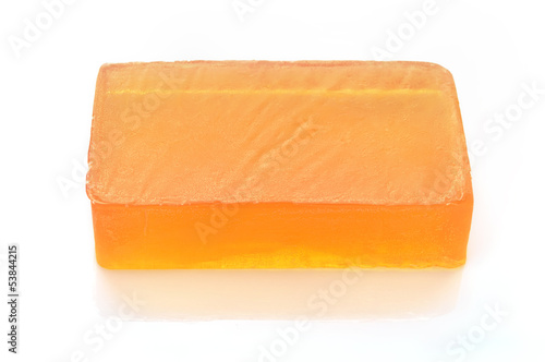 Orange handmade glycerin soap on white.